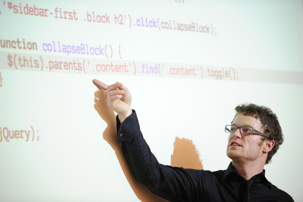man pointing at code